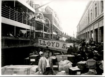 "Genoa, 1919. The emigrants' luggage being taken on board the ""Tomaso di Savoia"", a steamer belonging to Lloyd Sabaudo"
