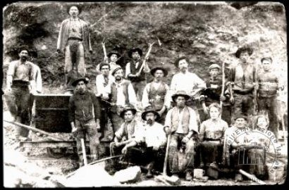 Austria, Holhsburg, about 1909. A group of miners with the women who cooked at their camp