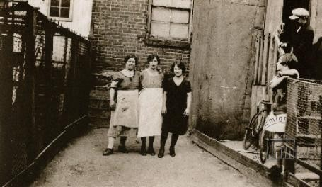 USA, New York. Paola Franchi, in the centre of the picture, with two friends in her courtyard