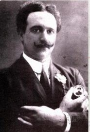 Giuseppe Piagentini pictured holding a photograph of his far-away fiancée